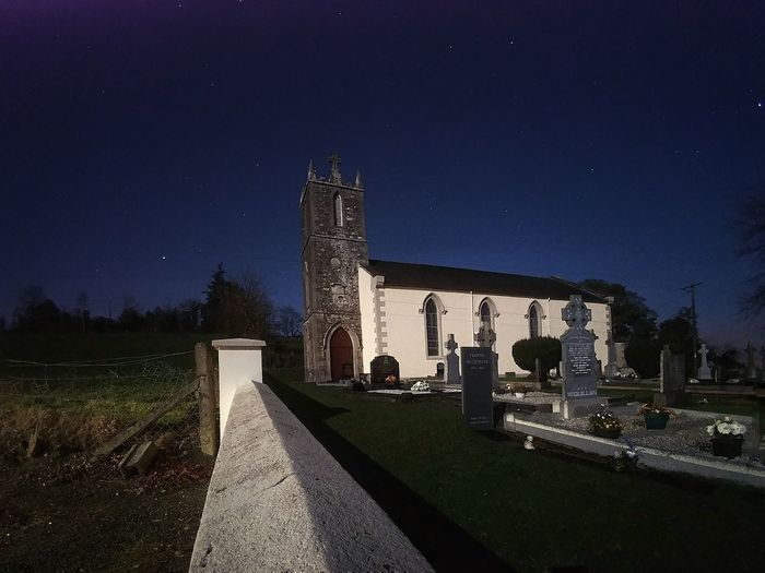 Panoramic view of historic building against sky at night