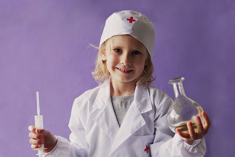 Good little doctor Doctor  Profession Kid Girl Healthcare And Medicine Occupation Science Research Scientific Experiment Holding Indoors  Portrait Education Laboratory Clothing Lab Coat Smiling One Person Women Scientist Medicine Medical Research Laboratory Glassware Studio Shot