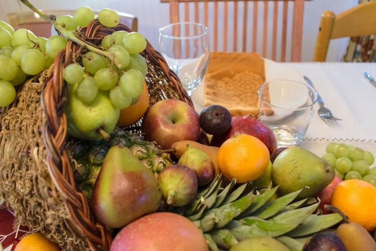 Apple Orange Pineapple Thanksgiving Basket Close-up Cornucopia Day Fig Food Food And Drink Freshness Fruit Grape Healthy Eating Indoors  No People Pear Table Tablecloth Variation Food Stories