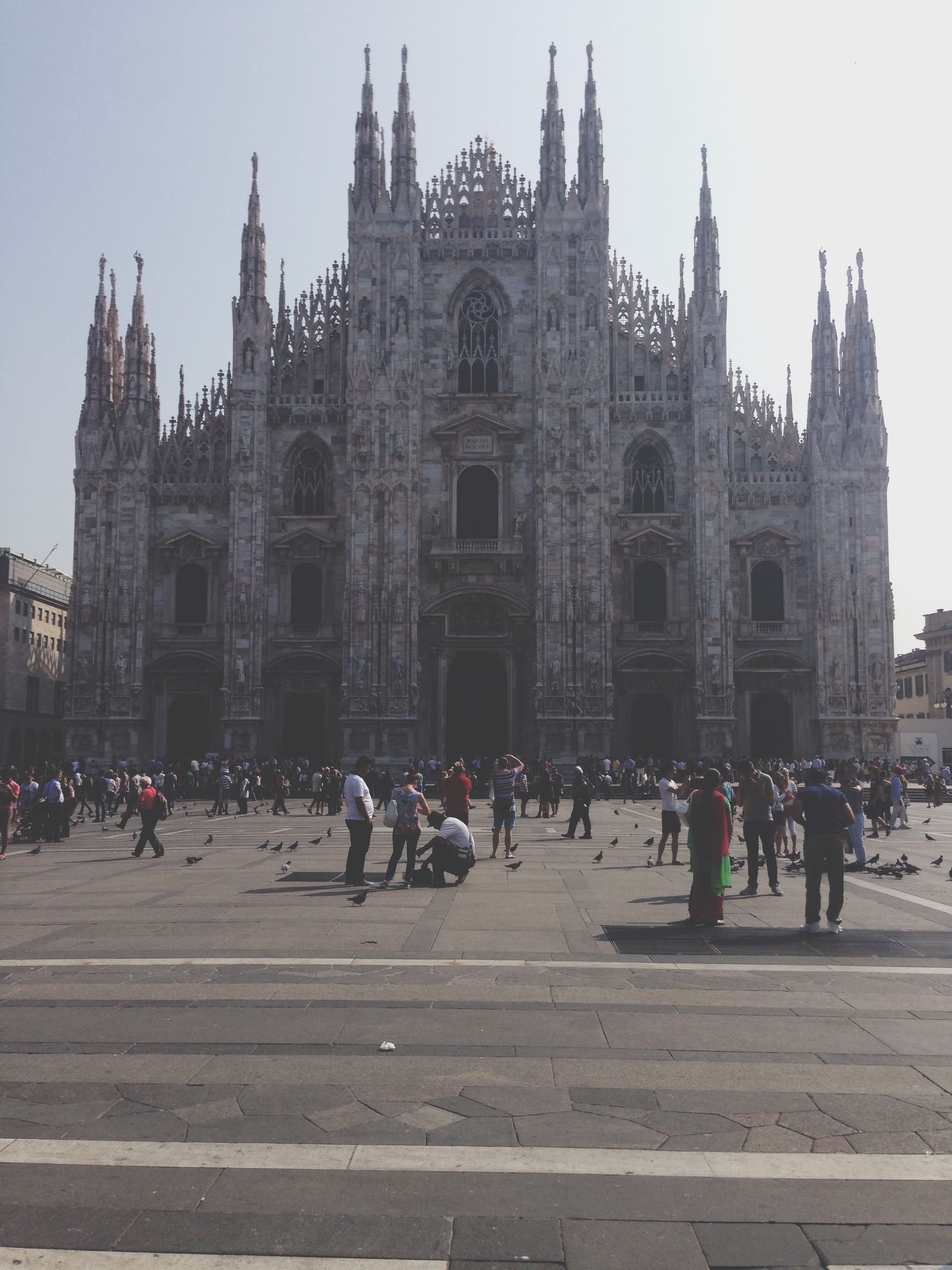 architecture, building exterior, built structure, large group of people, famous place, tourism, travel destinations, place of worship, history, religion, travel, international landmark, spirituality, cathedral, church, facade, tourist, capital cities