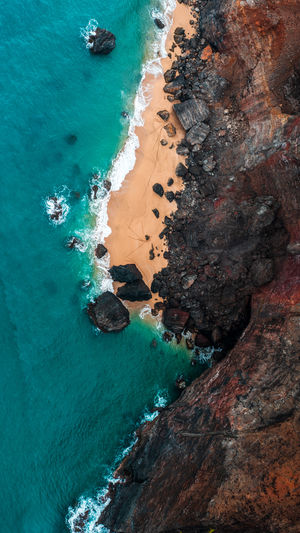 Beach Beauty In Nature Day High Angle View Land Motion Nature No People Outdoors Rock Rock - Object Rock Formation Scenics - Nature Sea Solid Sport Tranquil Scene Tranquility Turquoise Colored Water The Great Outdoors - 2018 EyeEm Awards