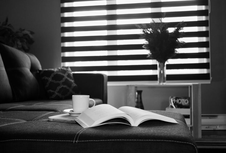 Open book on table at home