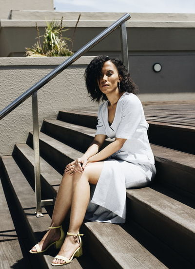 Mid adult woman sitting on steps