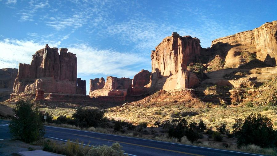 Rock formations by road at arches national park
