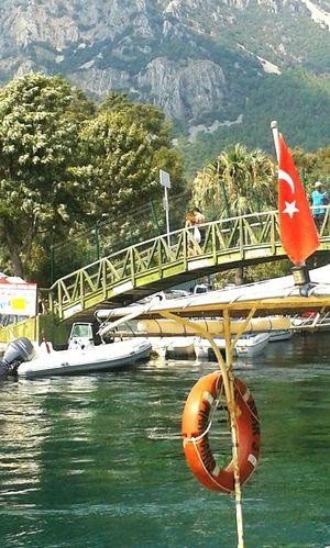 Wooden bridge in Akyaka, Muğla, Turkey Wooden Bridge Akyaka Muğla Akyaka Mugla Turkey Vacation Mountain Boat Sea Buoy People On Bridge Turkish Flag