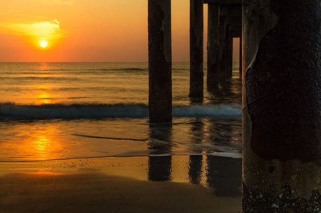Sunrise reflection by a fishing pier Fishing Pier Pier St Augustine Florida St Augustine, FL Beach Beauty In Nature Horizon Over Water Nature No People Orange Color Outdoors Reflection Scenics Sea Sky St Augustine Sun Sunlight Sunrise Tranquil Scene Tranquility Water