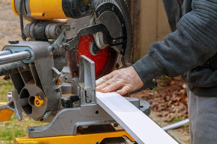Close-up of man working on machine