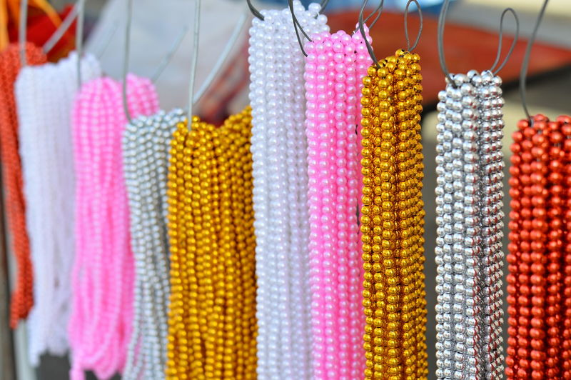 Close-Up Of Pearl Necklaces For Sale At Market Stall