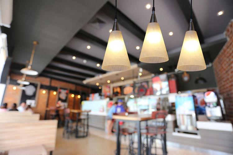 Illuminated pendant lights in restaurant