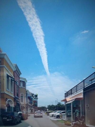 Clouds in the sky Transportation Mode Of Transportation Architecture Sky Building Exterior City Built Structure Car Cloud - Sky Motor Vehicle Vapor Trail Day on the move Nature Motion Land Vehicle No People Smoke - Physical Structure Outdoors Blue