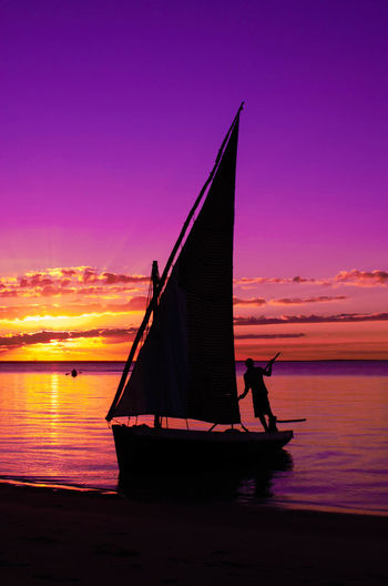 Day Dhow Dhow Boat Dhow Boat Ride Dhowcruise Men Mode Of Transport Nature One Person Orange Color Outdoors People Real People Scenics Sea Sky Sunset Sunset #sun #clouds #skylovers #sky #nature #beautifulinnature #naturalbeauty #photography #landscape Water