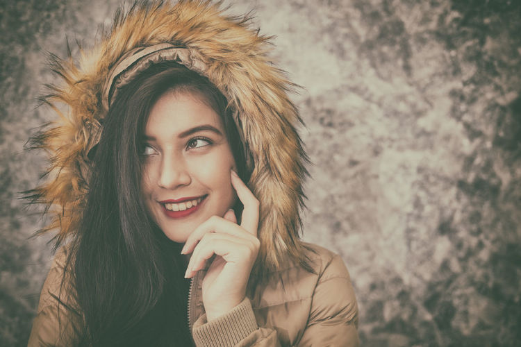 beautiful young woman wearing warm fashionable winter clothes to keep her from the cold Beautiful Woman Blond Hair Close-up Day Front View Happiness Lifestyles Long Hair One Person Outdoors People Portrait Real People Smiling Warm Clothing Young Adult Young Women