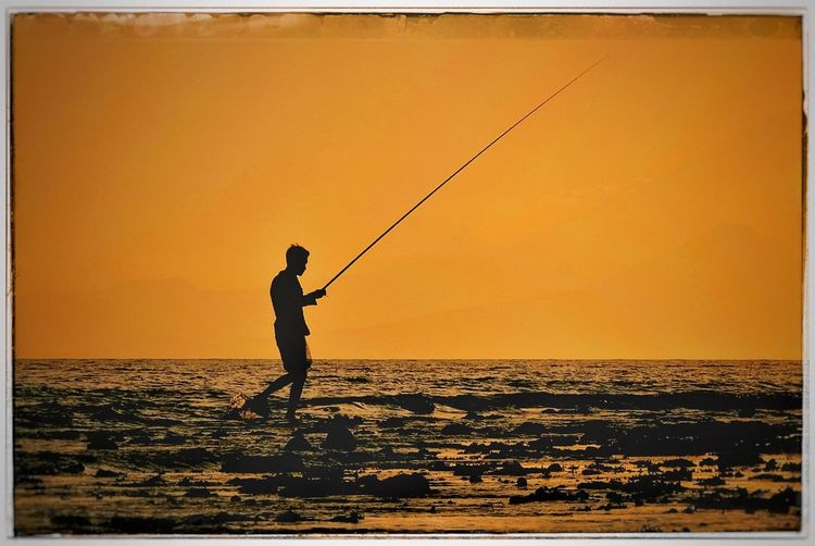 Fishing Fishing Rod Sea Horizon Over Water Sunset Water Real People Standing Fishing Pole Men One Person Holding Full Length Weekend Activities Fishing Tackle Tranquil Scene Nature Leisure Activity Silhouette Outdoors INDONESIA ASIA Lombok Fusherman Shilouette EyeEm Selects The Week On EyeEm Mix Yourself A Good Time Be. Ready.