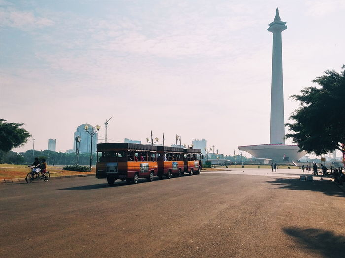 Bus on street in front of national monument