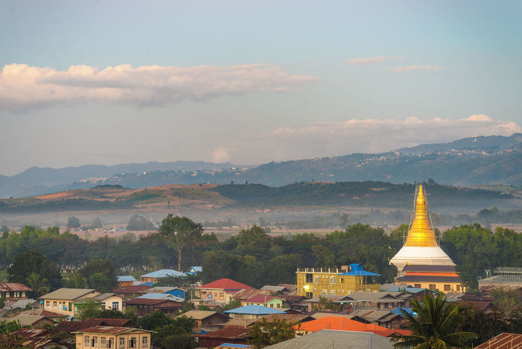 Nyaung Shwe, Inle Lake, Myanmar Architecture Built Structure Building Exterior Building Mountain Sky Cloud - Sky City Residential District Nature Place Of Worship No People Religion Spirituality Belief Outdoors Mountain Range Day Tree TOWNSCAPE Myanmar Burma Inle Lake Lake Tourism
