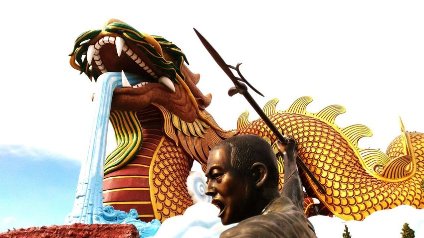 Fight with big dragon Adventure Club People Adventure Fighting Fight Dragon Devil Tried Spear Weapon Arms War Statue Scuplture Design Activity Landscape Travel Voyage China Chinese Culture Identity ASIA Asean Tale