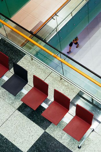 Chairs Diagonals Escalator Feet Flooring Illuminated Leisure Activity Lifestyles Modern Multi Colored Street Subway Station Tile Tiled Floor Walking