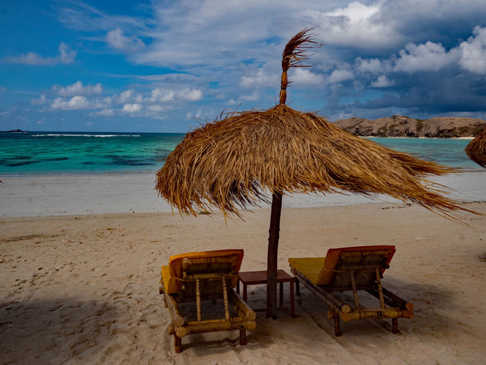 Beach Chairs on a beach Beach Life Lombok-Indonesia Bamboo Chair Beach Chairs Beauty In Nature Daytime Photography Raffia Umbrella