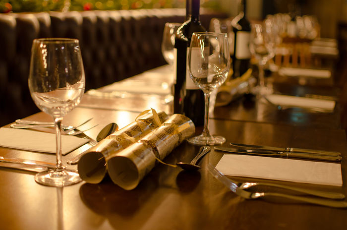 Christmas Function about to begin Christmas Christmas Crackers Close-up Day Drinking Glass Elegant Empty Table Fine Dining Function Indoors  Night No People Party Reastaurant Red Wine Seasonal Table Table Setting Wine Wineglass