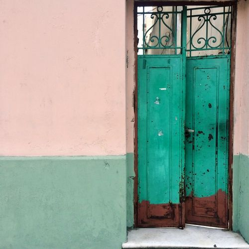 Wall Color Door Color Palette Door Closed Entrance Architecture Green Color Built Structure House Doorway Outdoors Protection No People Day Building Exterior Hinge Close-up Entry