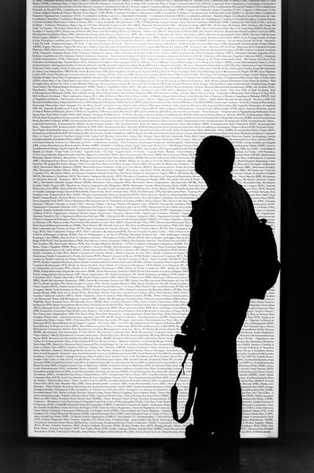 Silhouette and acronyms Light Art One Person Real People Standing Men Lifestyles Silhouette Text