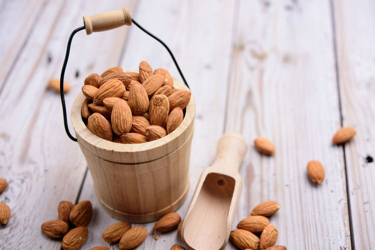 Food And Drink Wood - Material Food Table Nut Freshness Nut - Food Still Life Brown Indoors  Wellbeing No People Large Group Of Objects Almond Healthy Eating Close-up Bowl High Angle View Focus On Foreground Container Snack Salted