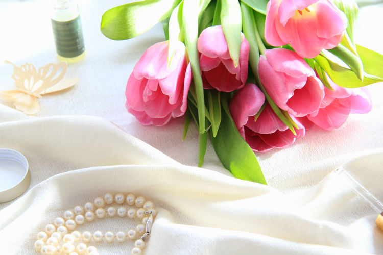 Flowering Plant Flower Freshness Beauty In Nature Inflorescence Plant Flower Head No People Close-up Indoors  Vulnerability  Still Life High Angle View Tulip Pink Color Fragility Pearl Jewelry Bouquet Beauty Wellness Spa Concept Tablecloth Essence Spring