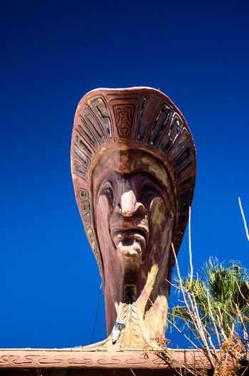 Funky Wooden Art Sky Art And Craft Human Representation Sculpture Representation Male Likeness Clear Sky Religion Statue Craft No People Blue Day Belief Architecture Nature Spirituality Low Angle View Creativity Outdoors Ancient Civilization