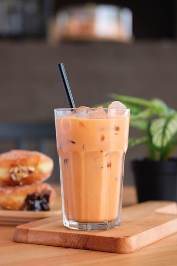 Food And Drink Food Straw Drink Drinking Straw Drinking Glass Refreshment Glass Table Household Equipment Freshness Healthy Eating Fruit Focus On Foreground Indoors  No People Close-up Wellbeing Still Life Ready-to-eat Orange Milk Tea