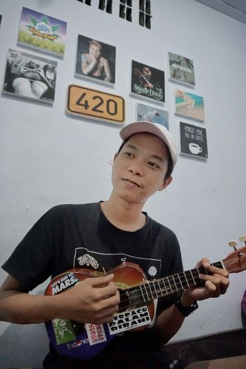 Ukulele. One Person Musical Instrument Playing Arts Culture And Entertainment Guitar Music Indoors