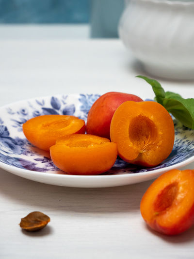 Close-up of orange fruits in plate