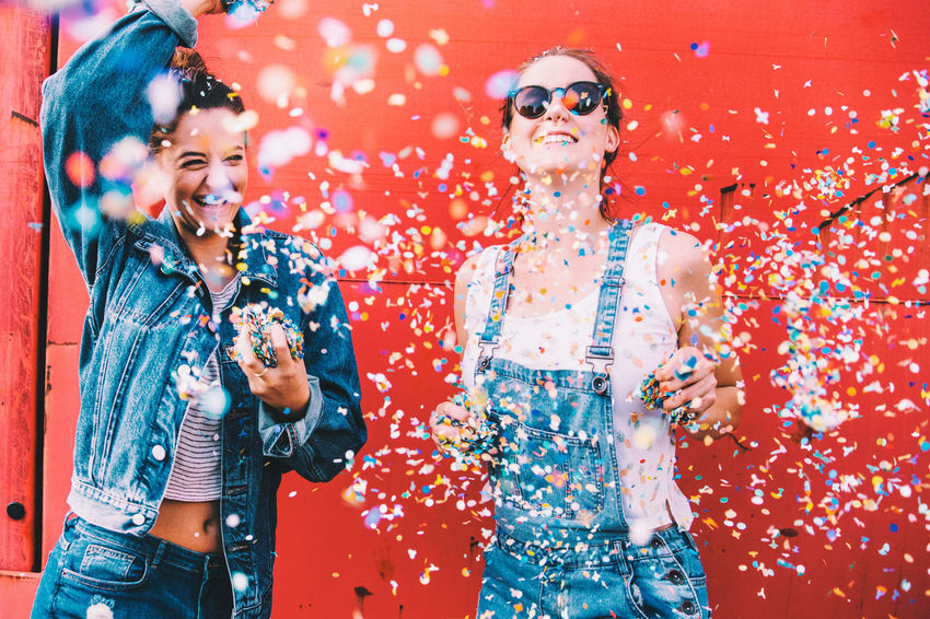 Happiness Happy Happy People Red Adults Only Beautiful Woman Carefree Casual Clothing Celebration Cheerful Colorful Confetti Enjoyment Fashion Friendship Fun Happiness Multi Colored Portrait Smiling Togetherness Two People Young Adult Young Women