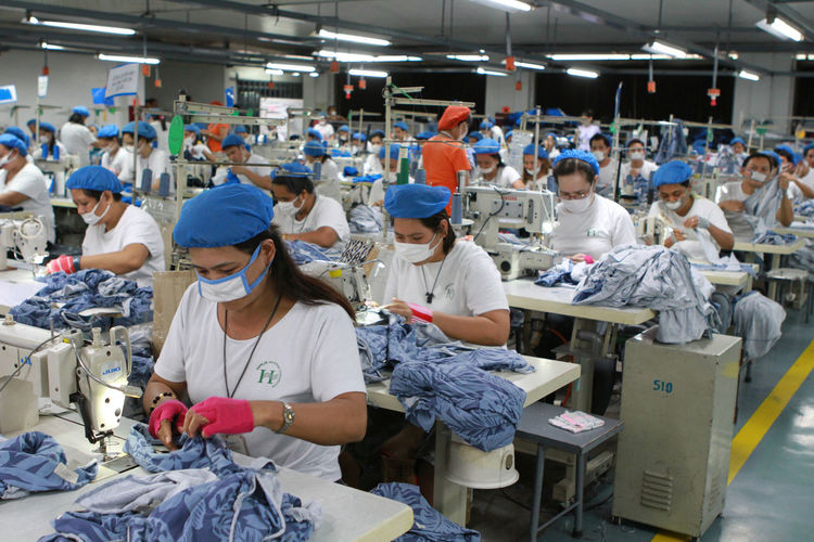 Workers in a factory. Apparel Casual Clothing Clothes Clothing Clothing Line Dress Garment Factory Head Gears Labor Labor Force Occupation Safety Sew Sewing Work Workers