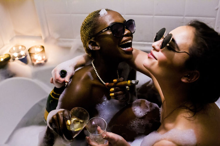 Bonding Champagne Cigar Classy Couple - Relationship Drink Friendship Happiness Happy Indoors  Leisure Activity Life Life Is A Beach Lifestyle Lifestyles Love Models Pearl Necklace  People Real People Shirtless Togetherness Two People Young Adult Young Women