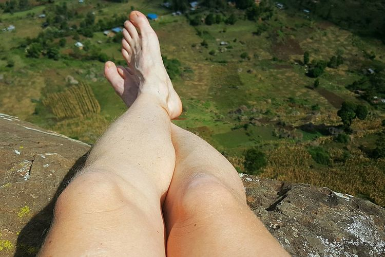 Relaxation Lifestyles Personal Perspective Leisure Activity Human Body Part One Person Nature Low Section Women Real People Adult Outdoors Mountain View Mountain Kenya Kerio Valley Kerio My Year My View Woman Legs Travel Destinations Rock - Object Adventure Cliff Lifestyle Travel