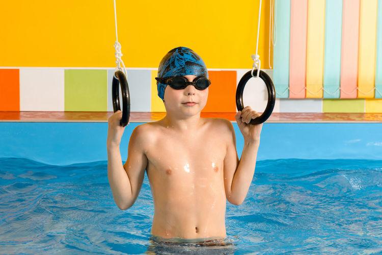 Shirtless boy in swimming pool