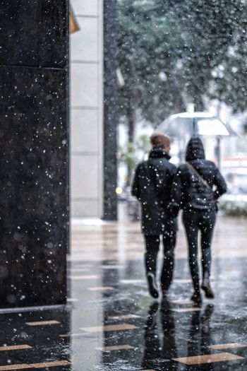 Snowy Tokyo ► Weather Snowing Two People Snow Wet Shades Of Winter Cold Temperature Winter Street Focus On Foreground Snowflake