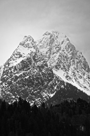 Mountain behind forest Mountain Sky Nature Mountains Berge Alpen Alps Bavaria Bayern Blackandwhite Black And White Monochrome Snow Winter Cold Temperature Snowcapped Mountain Mountain Peak Mountain Range Forest Trees Cloud - Sky Clouds Contrast Moody Sky Fine Art Photography