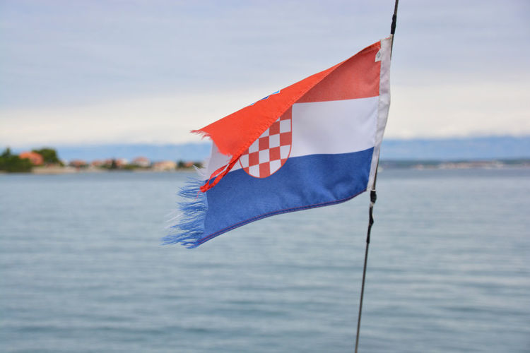 Croatia flag in the wind Boat Day Flag Focus On Foreground National Flag Sea Water Waterfront Wind