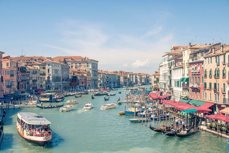 Boats in grand canal against sky
