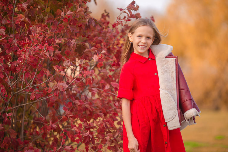 Portrait of a smiling girl standing outdoors