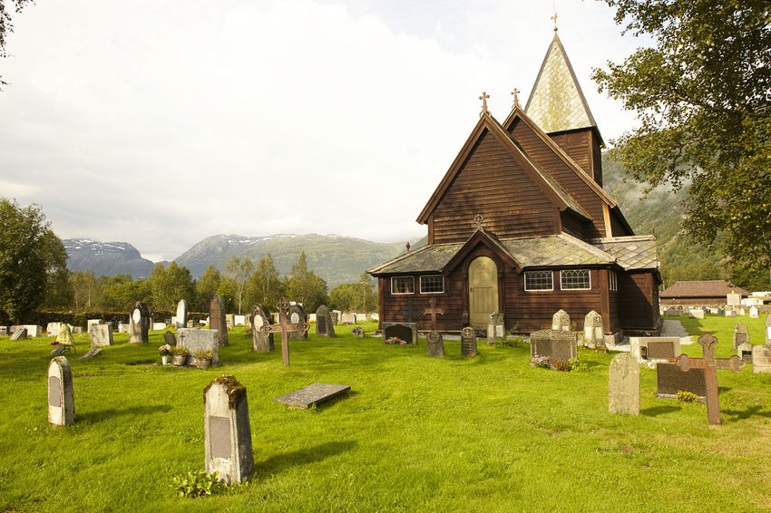 Røldal Stavkirke (Norway, Stave Church) Architecture Beauty Building Exterior Built Structure Church Day Grass Grave Graveyard Green Color Landscape Lawn No People Norway Outdoors Røldal Scenics Sky Spirituality Stave Church Stavkirke Sunny Tomb Tombstone
