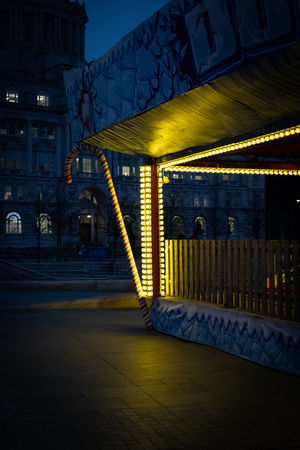 The Week on EyeEm Fairground Fairground Ride Architecture Illuminated Built Structure Night Building Exterior City Lighting Equipment Street Dusk No People Building Outdoors Communication Motion Transportation Street Light Footpath Connection Glowing Light