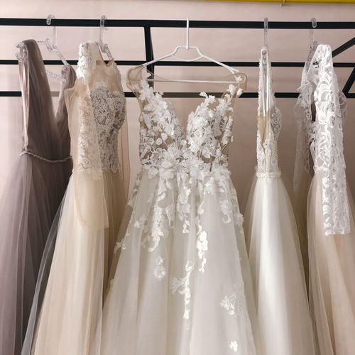 Wedding dresses hanging on rack in store