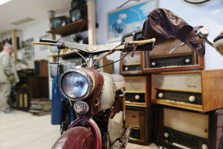 Close-up of vintage motorcycle with musical equipment in store