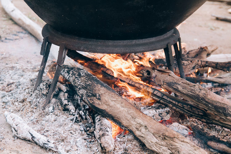 High angle view of firewood on barbecue grill