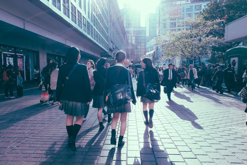 Architecture Built Structure Busy City City Cityscapes Crossing Culture Girls Japan Japanese  Japanese Culture Lens Flare Light And Shadow Motion Pedestrian Shadow Shibuya Shibuya Crossing Street Streetphotography Student Sunset Tokyo Walking