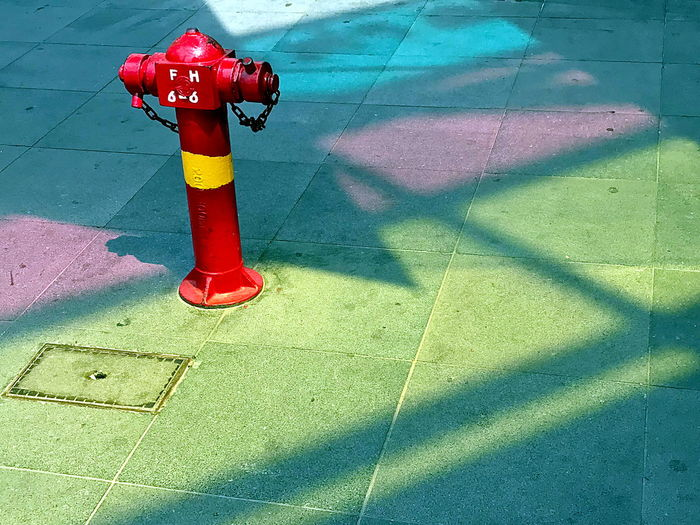 Singapore fire hydrant Shadow Red Fire Hydrant Day Sunlight Nature Security Footpath Protection Safety No People High Angle View Outdoors Flooring Sidewalk Tile City Street Accidents And Disasters Equipment Tiled Floor