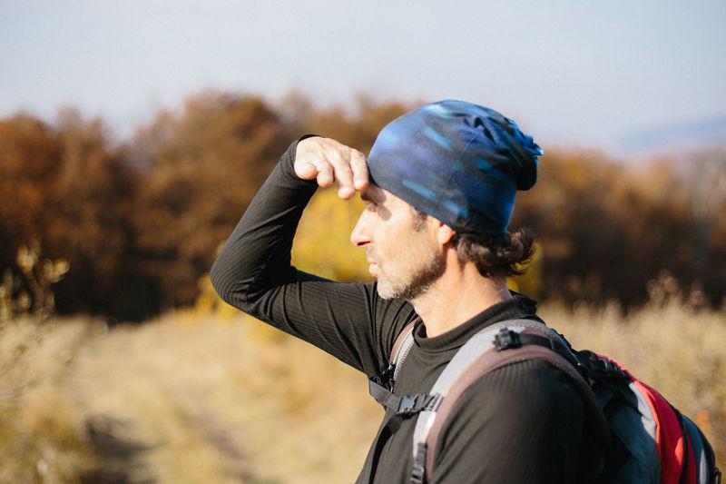 Portrait of man wearing mask on field
