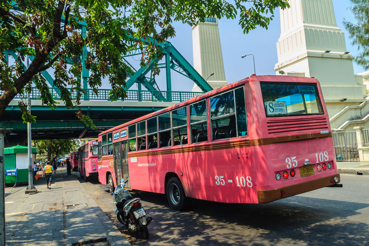 Bangkok, Thailand - March 2, 2017: Pink bus line number 8, starting point from the memorial bridge (Saphan Phut) to Happy Land, Minburi. Bus nummber 8 line is famous of fast and swiftly in Bangkok. Bus Trip Bus Terminal Station - Entrance Number 8 Pink Pink Bus Saphan Phut Architecture Building Building Exterior Built Structure Bus Bus Line Bus Terminal Bus Travel City Day Fast And Furious Fast And Furious 8 Fast And Swiftly Happy Land Incidental People Land Vehicle Memorial Bridge Minburi Mode Of Transportation Motor Vehicle Nature Outdoors Plant Red Road Street Sunlight Swiftly Transportation Tree